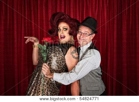 Man Holding Drag Queen
