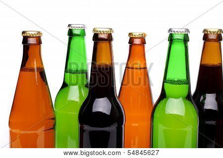 Bottlenecks and bottles of beer. Close up.