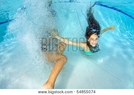 Two Girls Playing Underwater