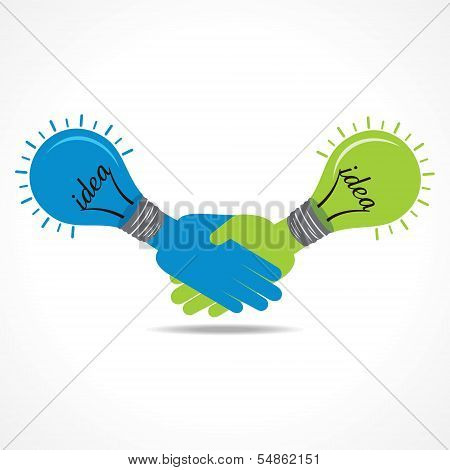 Businessman handshake background with bulb