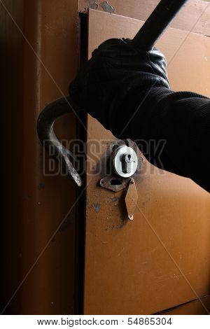 Burglar breaking the safe