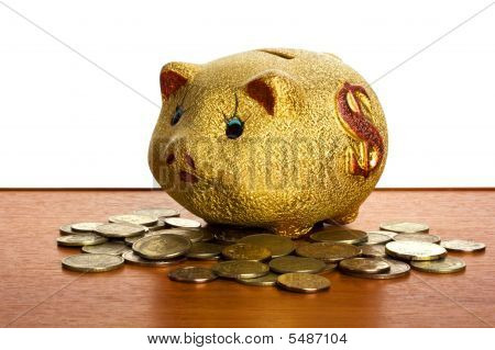 Money-box On The Table With White Background