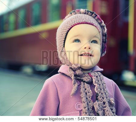Little cute girl ready to vacation on railway station, baby girl fashion model go on travels, toned poster
