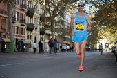 VALENCIA - NOVEMBER 17: Abdel Kader El Hamdi (number 645) runner participates in Valencias marathon on November 17, 2013 in Valencia, Spain poster
