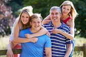 Family With Teenage Children Walking In Countryside poster