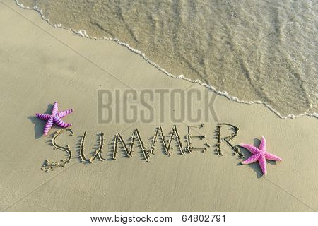 Word Summer Written in the Sand on a Beach