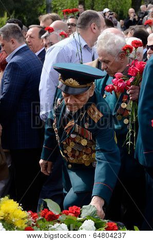 Old soldier come put flowers to Eternal Flame during celebration Victory Day in Odessa,Ukraine