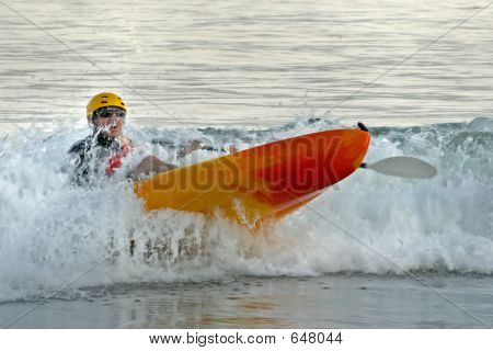 Kayaker In The Surf