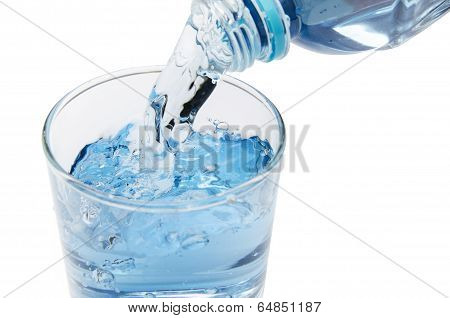 Pure Water Is Emptied Into A Glass Of Water From Bottle