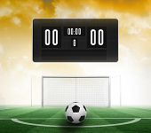 Black scoreboard with no score and football against football pitch under yellow sky poster
