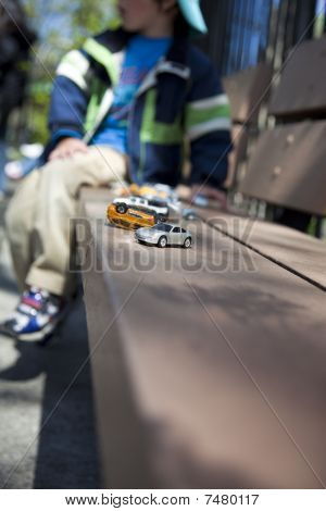 Little Boy With Toy Cars