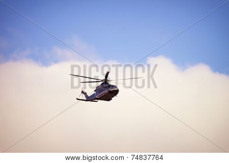Russian Prime Minister`s Helicopter In The Air In Front Of Clouds