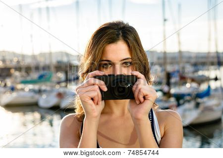 Tourist On Taking Picture By The Harbor