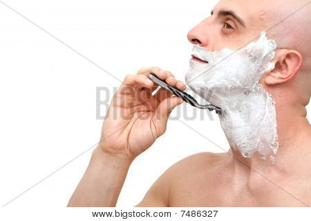 Man Shaving With A Razorblade
