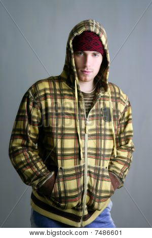 Young Student Boy With Red Cap And Yellow Jacket