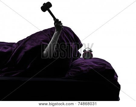 one person smashing alarm clock in bed waking up smashing alarm clock silhouette studio on white background poster
