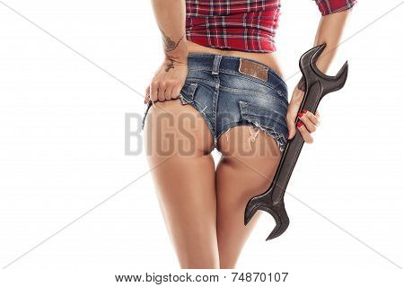 Nice Sexy Woman Mechanic Showing  Bum Buttock  And Holding Wrench