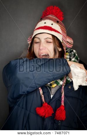 Woman Sneezing Into Her Arm