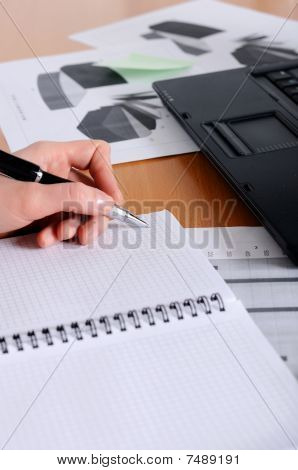 Hand Of A Young Business Woman Working With Documents