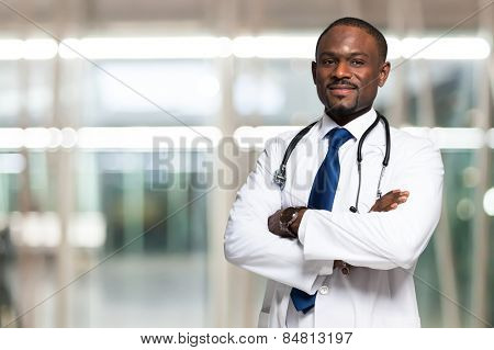 Portrait of an handsome smiling doctor