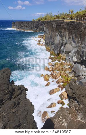 Black volcanic lava sea coast at Reunion island, France. poster