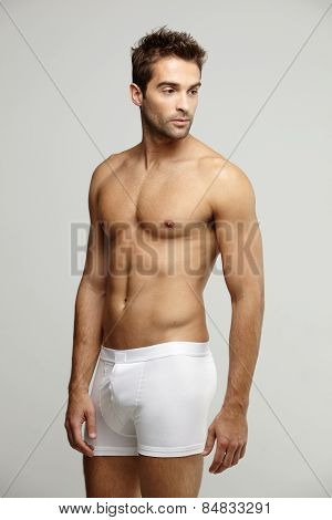 Mid adult man in underpants studio shot
