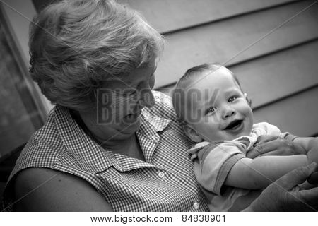 Cute baby boy with his grandmother poster