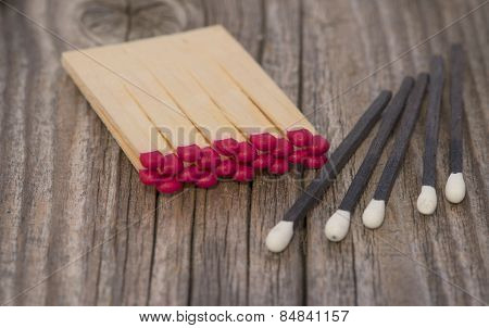Red And Black Matches On Wood