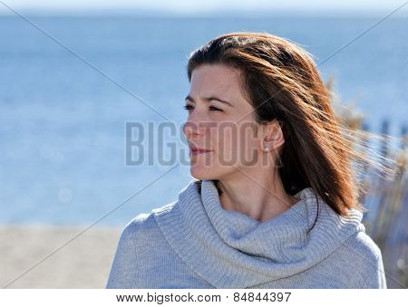 Pretty woman with confident smile portrait at the beach