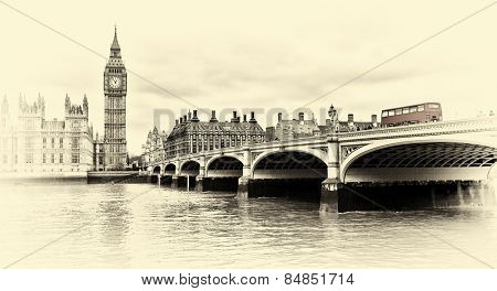 Red bus on Westminster Bridge by the Houses of Parliament sepia vintage