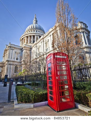 St. Paul's Cathedral and Red Telephone Box in London.  poster
