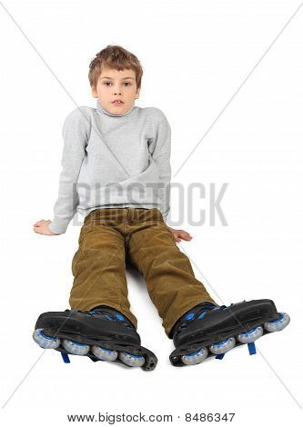 Little Roller Boy Sitting And Looking At Camera Isolated On White