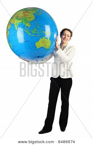Young Woman In White Jacket Standing And Holding For Two Hands Big Inflatable Globe, Isolated