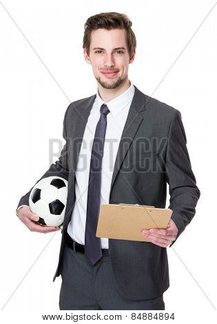 Soccer manager hold with strategy plan and soccer ball