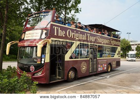 SINGAPORE - JANUARY 26, 2015: Singapore has over 10 million visitors each year. The Original Tour Singapore Sightseeing - this company offering Singapore City bus tours for tourists.