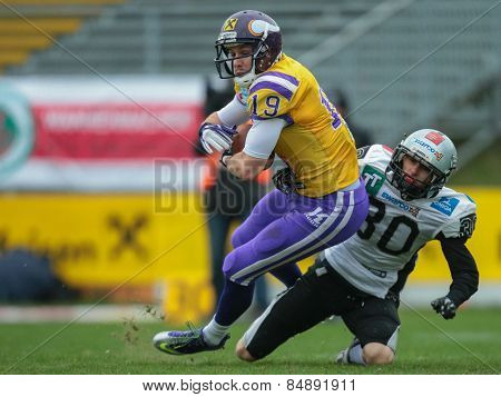 VIENNA, AUSTRIA - MARCH 23, 2014: WR Stefan Postel (#19 Vikings) catches the ball in an AFL football game.