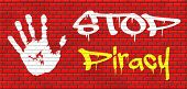 piracy stop illegal download of movies and music and illegal copying copyright and intellectual property protection protect copy of trademark brand graffiti on red brick wall, text and hand poster