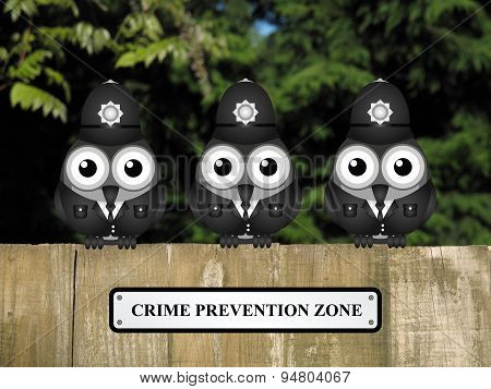 Comical British bird policemen with crime prevention zone sign perched on a timber garden fence against a foliage background poster