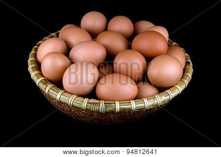 Basket Of Fresh Hens Eggs On Black Background