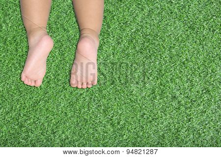Baby's Feet On Artificial Turf