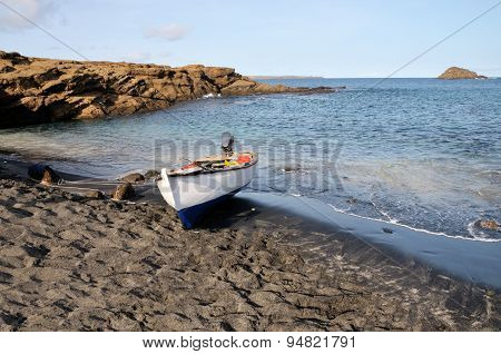 Wooden Fishing Boat On Black Sand Beach