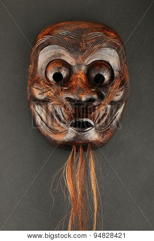 Japanese Wooden Carved Theater Face Mask Isolated On Black