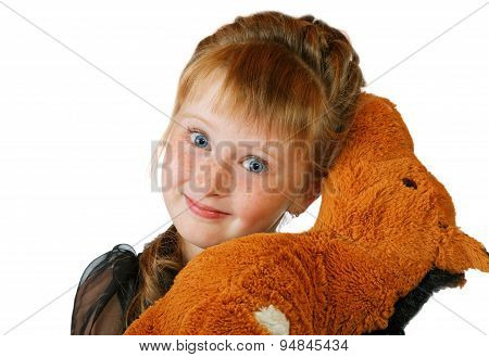 Girl With A Soft Toy On A White Background