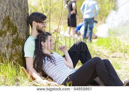 Couple Relaxing At Picnic