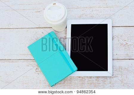 diary a tablet computerand lilies of valley on the table poster