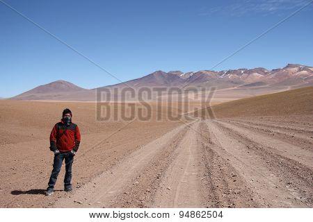 Young man tourist in Atacama Desert in Bolivia