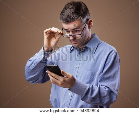 Man Adjusting His Glasses