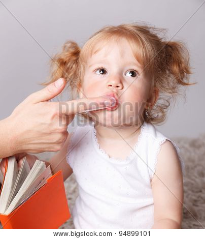 Cute Baby Getting Her Teeth brushed