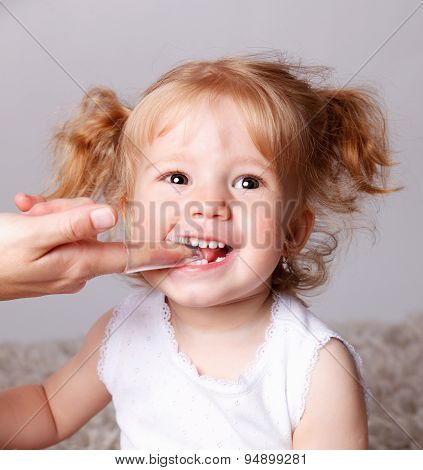 Happy Little Child Getting Her Teeth Brushed With Finger Toothbrush