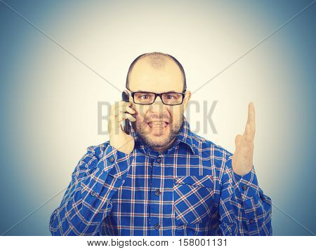Angry Man In Glasses Yells Into  Phone.